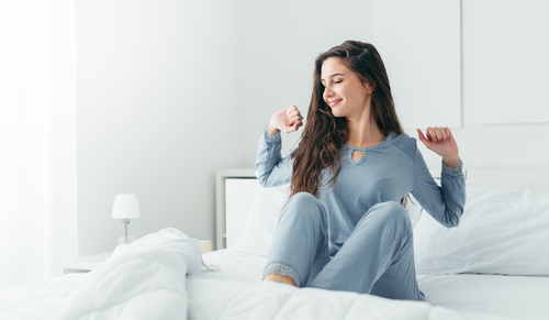 Young woman waking up rested